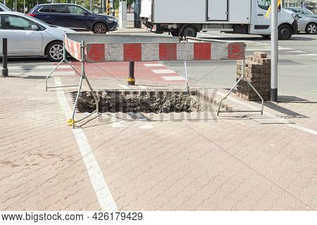 Excavation Fencing. Protective Barriers And Fences During Construction Work In The City