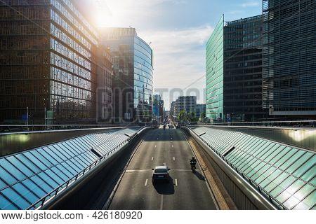 Street traffic in Brussels near European Commission building on sunset. Rue de la Loi , Bruxelles, Belgium