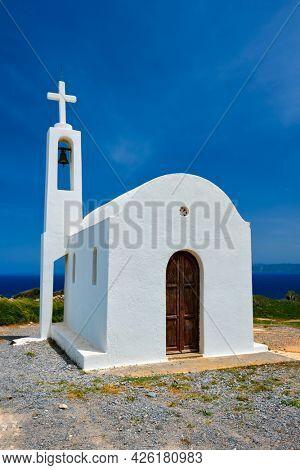 Greek traditional white washed orthodox curch. Crete island, Greece