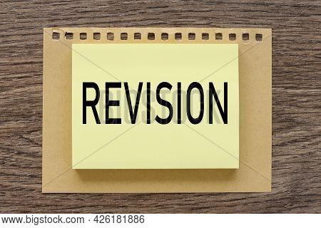 Revision. Text On A Wooden Table, On A Bright Sticker