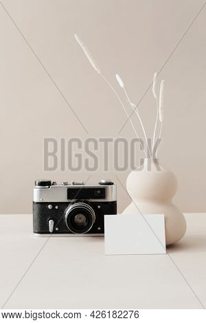 Blank business card with a camera