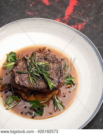 Luxury Food. Plate With Fried Or Griled Meat Steak. Juicy Veal Medallion With Rosemary In Tomato Sau