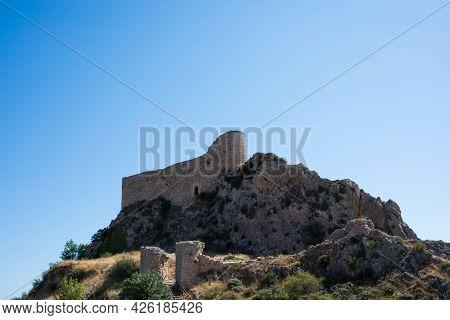 View From Below Of Las Rojas Castle, On Top Of A Hill At Poza De La Sal, Merindades, Burgos, Spain,