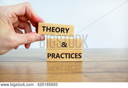 Theory And Practices Symbol. Wooden Blocks With Words 'theory And Practices'. Beautiful Wooden Table