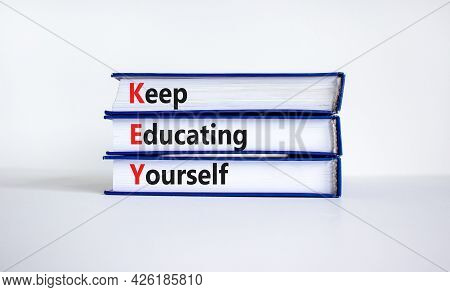 Key, Keep Educating Yourself Symbol. Books With Words 'key, Keep Educating Yourself'. Beautiful Whit