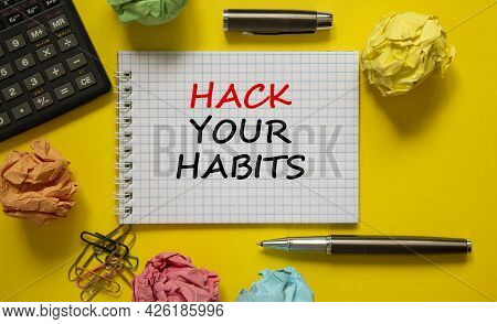Hack Your Habits Symbol. White Note With Words Hack Your Habits On Yellow Table, Colored Paper, Colo