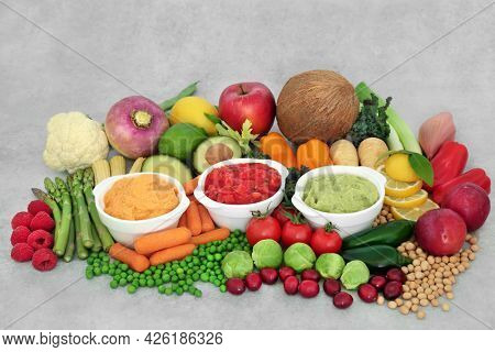 Healthy fresh immune system boosting vegan food for ethical eating high in protein, antioxidants, anthocyanins, lycopene, smart carbs, vitamins and fibre. Plant based health foods concept.