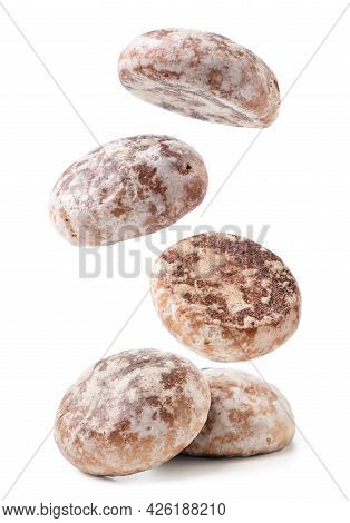 Gingerbread Cookies Are Falling On A Heap Close-up On A White Background. Isolated