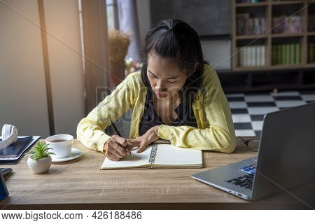 Female Hand Of Planner Writing Daily Appointment On 2021 Calendar Book. Woman Mark And Note Schedule