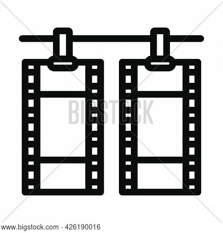 Icon Of Photo Film Drying On Rope With Clothespin. Bold Outline Design With Editable Stroke Width. V