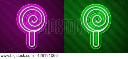 Glowing Neon Line Lollipop Icon Isolated On Purple And Green Background. Candy Sign. Food, Delicious