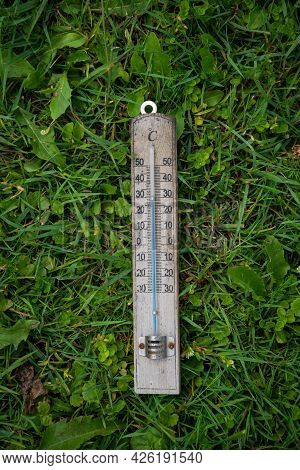 Thermometer On Grass Top View Copy Space