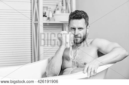 Man Wash Muscular Body With Foam Sponge. Hygiene And Health. Sexuality And Relaxation. Desire And Te