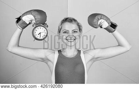 Time Management Skills. Battle For Self Discipline. Woman Holding Clock Boxing Gloves. Boxer Fightin