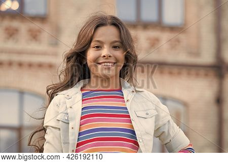 Small Girl Gorgeous Hairstyle Adorable Smile Urban Background, Happy Childhood Concept