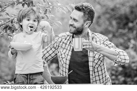 Healthy Breakfast. Father Son Eat Food And Have Fun. Little Boy And Dad Eating. Nutrition Kids And A