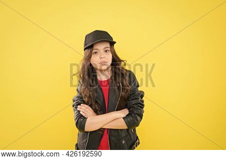 Declaring Her Own Style. Little Child With Confident Look Yellow Background. Wearing Casual Style. T