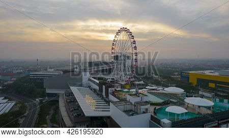 Aerial View Of Illuminated Ferris Wheel At Sunset, Colorful Sky And Ferris Wheel. Jakarta, Indonesia