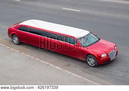 Krasnoyarsk, Russia - June 28, 2021: Red Chrysler 300c Limousine On City Road