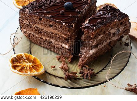 Selective Focus. Slice Of Chocolate Cake With Blueberries On Top On Gray Background. Copy Space. Cop
