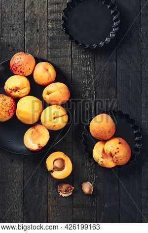 Fresh Apricots On A Dark Wooden Table, Top View.