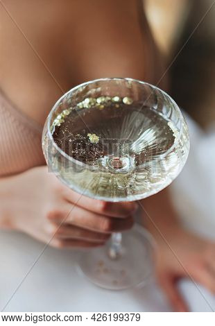 From Above Soft Focus Of Anonymous Woman With Glass Goblet Of Fizzing Champagne Enjoying Banquet