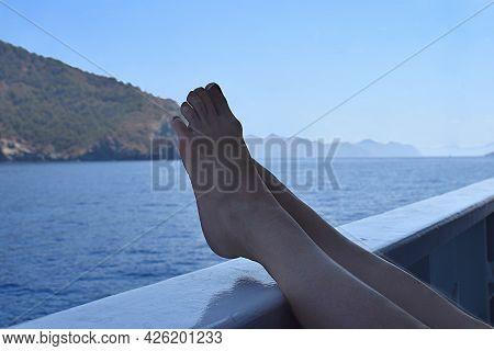 Relax On Board The Pleasure Ship. Women's Legs.