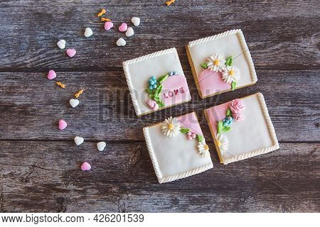 Gingerbread Valentines Cookies Split Into Pieces With Sprinkles On Wooden Background