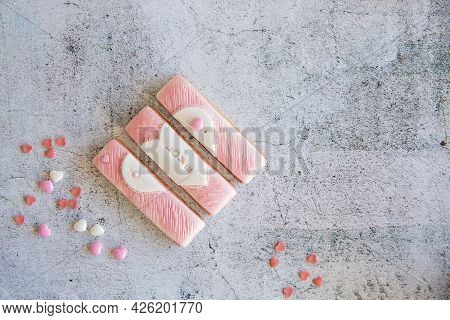 Gingerbread Valentines Cookies Split Into Pieces With Sprinkles On Grey Background