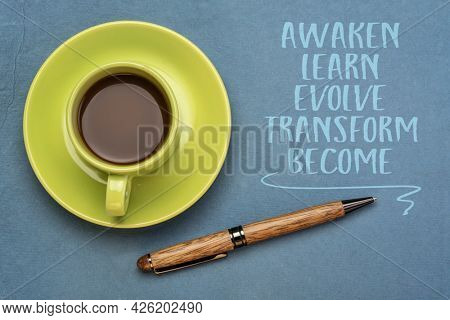 Awaken, learn, evolve, transform and become - inspirational words of wisdom. Handwriting on a handmade paper with a stylish pen and coffee, lifestyle, career and personal development concept