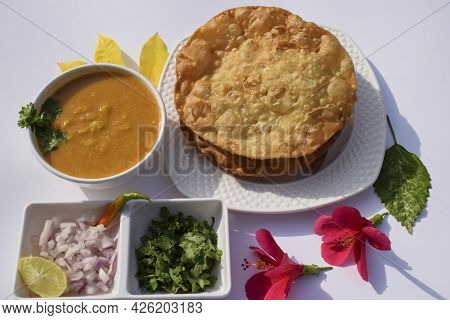 Popular Delicious Sindhi Cuisine Dish Item Dal Pakwan With Chopped Onions, Coriander, Green Chilly.