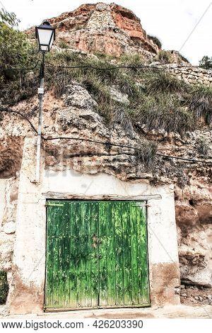 Old Garage With Green Wooden Door Excavated In The Mountain In Alcaraz