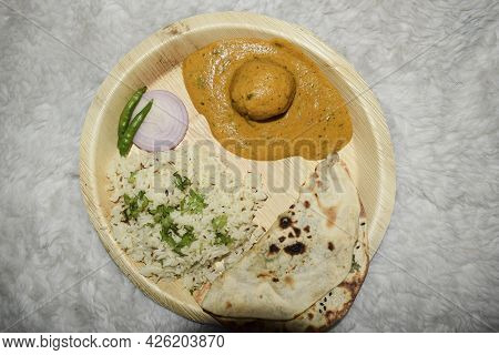 Indian Home Cooked Meals For Dinner Or Lunch Jeera Rice, Malai Kofta, Dal Makhani, Butter Naan With