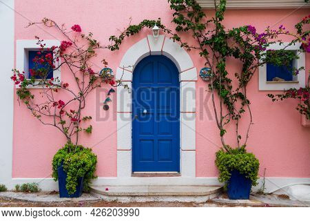 Traditional Greek House With Colorful Blue Door And Pink Walls At Asos Village. Assos Peninsula Famo