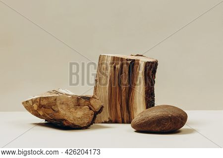 Natural Materials Stone And Wood On A Beige Background, A Natural Background For Your Product. Fashi