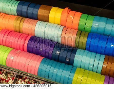 Textural Silk Ribbons On A Shelf In A Store. Homemade Concept. Multi-colored Ribbons In The Shop For
