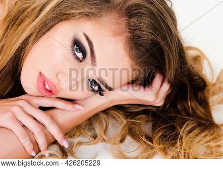 Concept Of Relaxation, Comfort, Dreaming. Attractive Woman With Long Hair Lies In Bed And Dreaming A