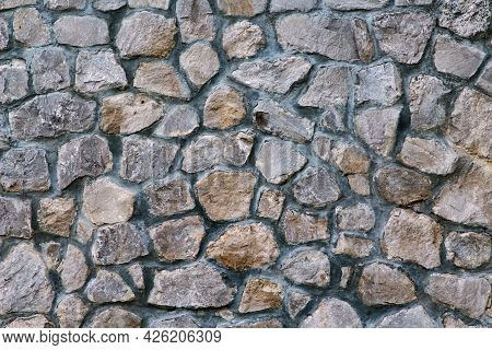 Masonry Rock Wall Texture. Part Of Old Castle Stone Wall Background. Grey Stone Siding With Differen