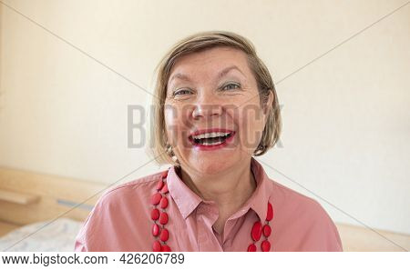 Happy Middle Aged Mature Gray Hair Senior Woman, Smiling Old Woman Wearing Glasses At Home, Positive
