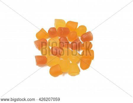 Close-up Orange And Yellow Multivitamin Gummies On White Background.