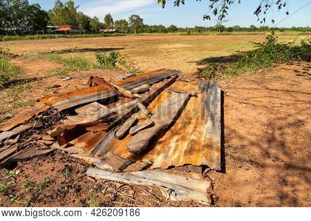 Old Dilapidated Zinc Lay On The Ground, Outdoor.