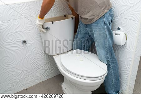 Workerman Performs Repair Of Toilet Bowl,  To Repair The Pipe From The Toilet