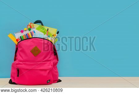 Back To School. Backpack For School Or College With Bright Colorful School Supplies On Blue Backgrou