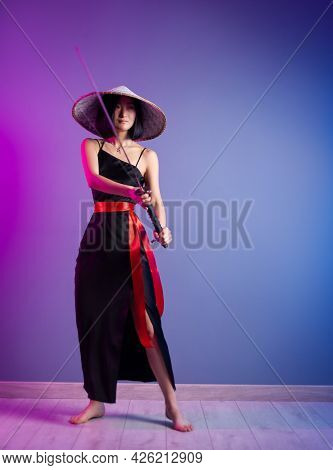 Slender Asian Woman An Asian Hat With A Katana In Her Hand Image Of A Samurai