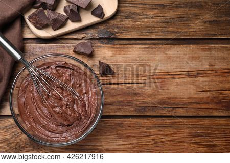 Chocolate Cream With Balloon Whisk On Wooden Table, Flat Lay. Space For Text
