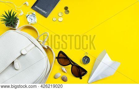 Summer Travel Concept. Traveler's Accessories. Passport, Money, Sun Glasses On A Yellow Background.