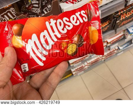 Belgrade, Serbia - July 4, 2021: Logo Of Maltesers On A Bag Of Their Candies For Sales. Maltesers Is
