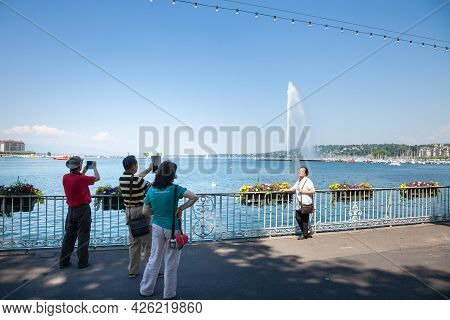 Geneva, Switzerland - June 19, 2017: Group Of Asian Tourists From China Taking Pictures And Smiling