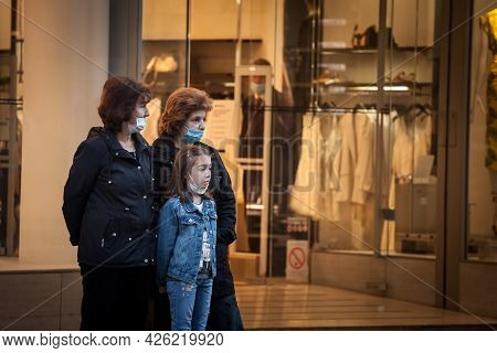 Belgrade, Serbia - June 1, 2021: Two Senior Old Women, Grandmothers, Standing In A Street Wearing A