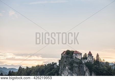 Selective Blur On The Bled Castle, Also Called Blejski Hrad, During Summer, At Sunset, By The Mounta